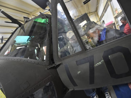 """""""This,"""" said Dave Hess of Pottsville, """"brings back a lot of memories. A lot of memories."""" Hess, a Vietnam veteran, was surprised by his family with a visit to the Lancaster Airport, where they are restoring a Huey helicopter."""