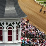 Spectators watch the eighth race from under the Churchill Downs' Twin Spires before the 2013 Oaks.