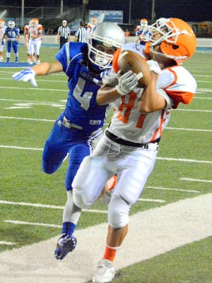 Artesia's Brandon Reza goes out of bounds against Carlsbad's Jordin Molina during the Eddy County War game on Friday Sept. 25, 2015. The Bulldogs have won nine of the last 11 meetings with the Cavemen.