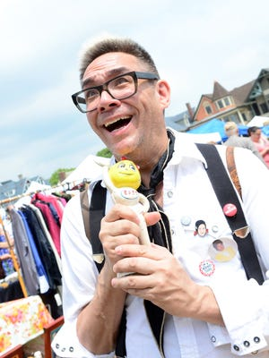 Ocean Grove held its Giant Spring Flea Market on Saturday. Jerry Tjhung of N.Y.C. cherishes a new find at the sale.