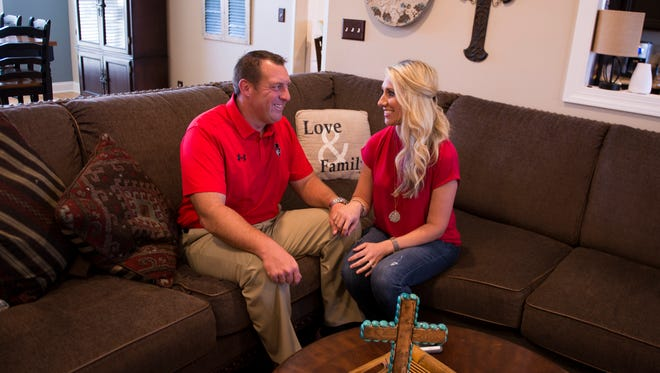 Joshua Eargle, Austin Peay's offensive line coach, and his wife Kristen Eargle, Digital Network Sideline Reporter, pose for a portrait inside their home on October 4, 2017.
