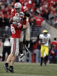 Ohio State's Joel Penton and Jay Richardson celebrate