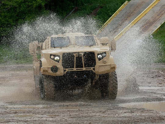 Oshkosh Corp.'s JLTV maneuvers through the test course.