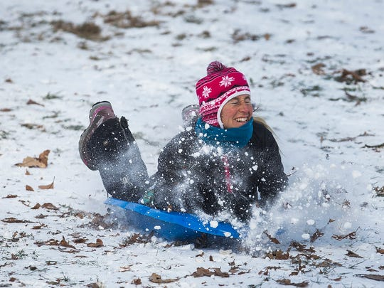 Jen Sotherland sleds down a hill at McCulloch park