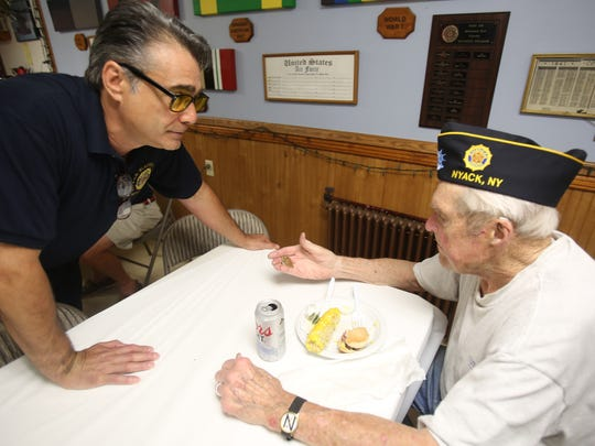 From left, Commander of C.R. & R.O. Blauvelt Post 310 Anthony DelRegno shows fellow veteran Bruce Cameron a Purple Heart that was found in Rockland County, during a meeting at American Legion Post in Nyack July 13, 2017.