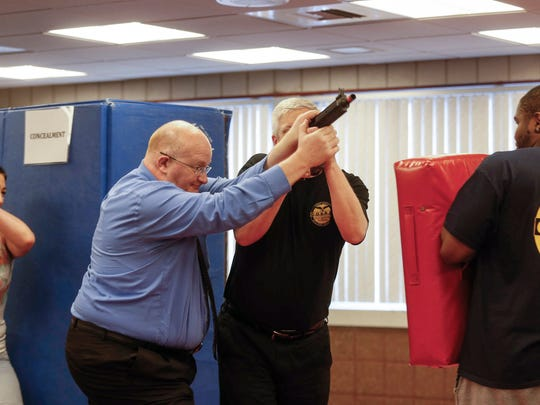 Troy Thompson of Urbandale interferes with a shooter during an active shooter self-defense class at the Iowa Center for Higher Education building on Wednesday, April 11, 2018, in Des Moines.