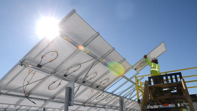 Consumers Energy plans to install acres of solar panels, like these, at Western Michigan and Grand Valley State universities as part of a new renewable energy program.