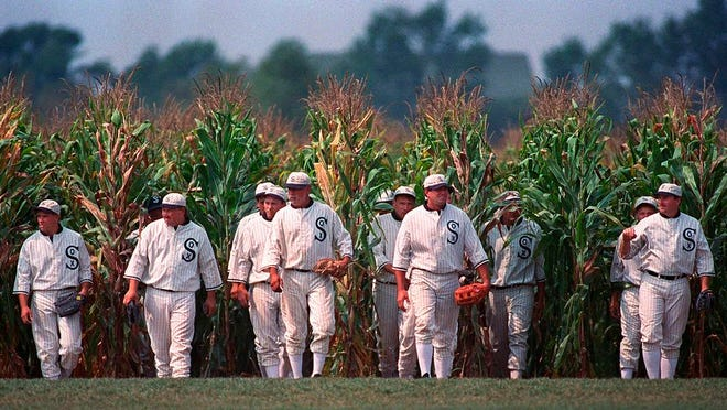 "In this undated file photo, people portraying ghost players emerge from a cornfield as they reenact a scene from the movie ""Field of Dreams"" at the movie site in Dyersville, Iowa. The 1989 film was No. 6 in The Associated Press' Top 25 favorite sports movies poll."
