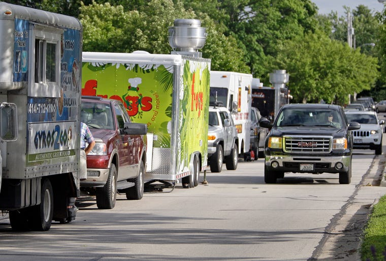 Food trucks line the curb near Vollrath Park Monday July 14, 2014 in Sheboygan.