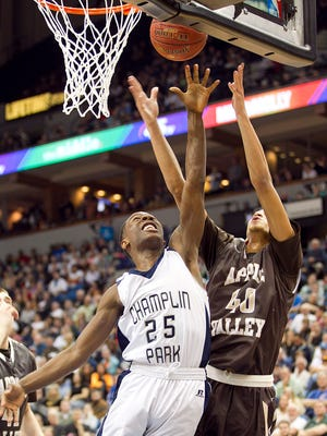 Champlin Park guard McKinley Wright (25) committed to Dayton and Archie Miller.