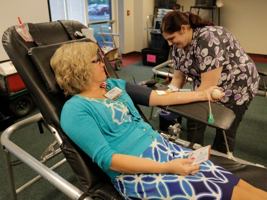 Sandy Dietz of Aurora donated her first gallon of blood Wednesday. Her donation was drawn by Brieanna Pack of Community Blood Center.