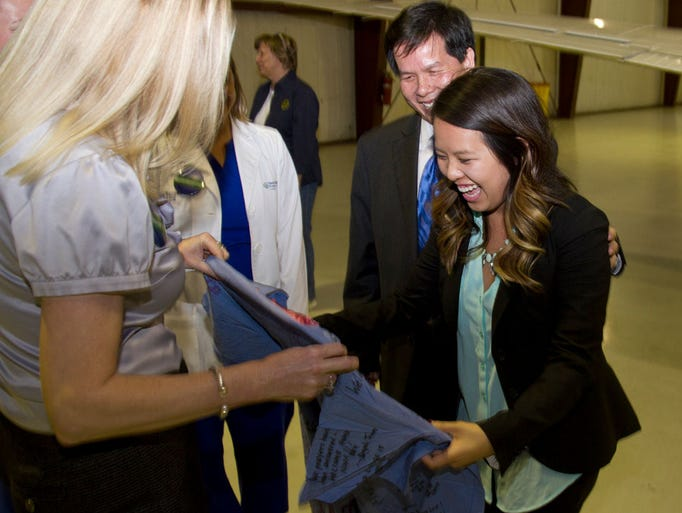 Dallas nurse nina pham is welcomed at fort worth meacham airport after