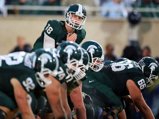 Connor Cook lining up the MSU offense in 2013 against