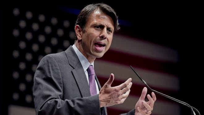 FILE - In this Feb. 11, 2012 file photo, Republican Gov. Bobby Jindal of Louisiana addresses activists from America's political right at the Conservative Political Action Conference (CPAC) in Washington. Jindal planned to file a lawsuit Wednesday Aug. 27, 2014 against the Obama administration, accusing it of illegally manipulating federal grant money and regulations to force states to adopt the Common Core education standards. (AP Photo/J. Scott Applewhite, File)