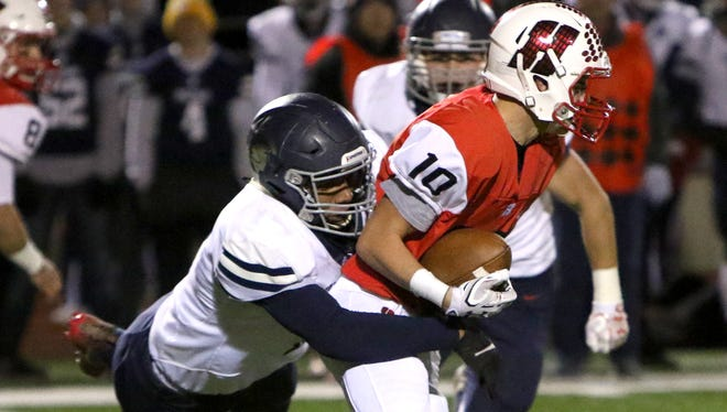 Brookfield East's Caleb Wright sacks Homestead quarterback Jared Schneider in a playoff game Friday night.