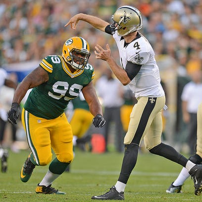 Green Bay Packers nose tackle Bruce Gaston (99) rushes