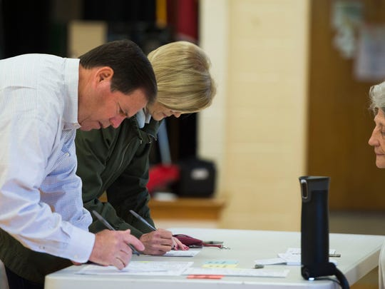 Tom Spangler, Knox County sheriff candidate prepares to vote with his wife Linda Spangler at Gap Creek Elementary School Tuesday, May 1, 2018.