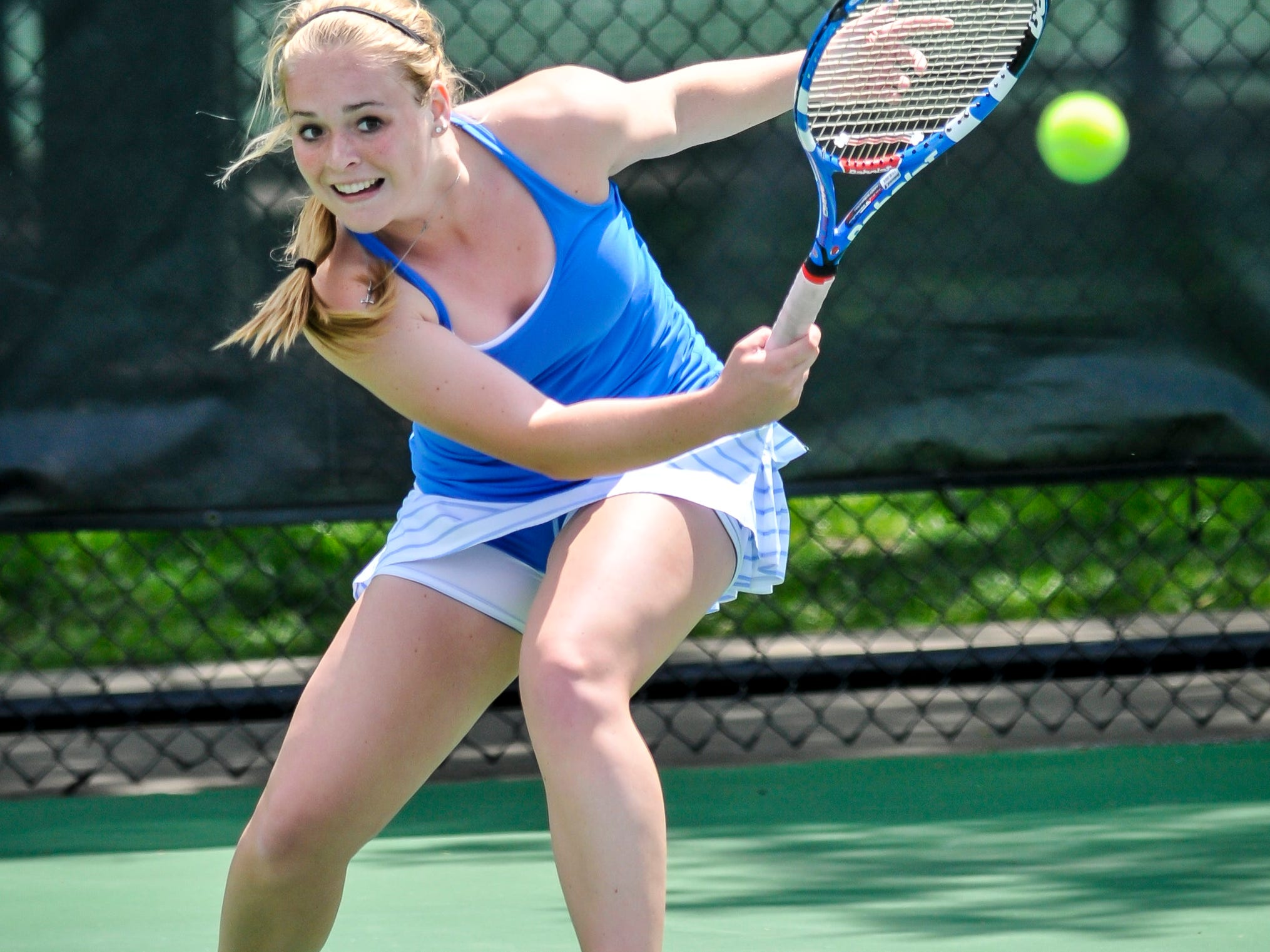 Meredith Laskey of Highlands returns the ball in the 2014 Kentucky state tennis tournament.