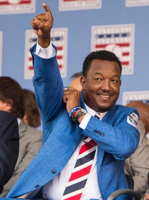 Hall of Fame Inductee Pedro Martinez beckons for a relief pitcher jokingly during the induction ceremony Sunday.