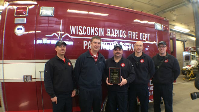Wisconsin Rapids Fire Department personnel Lt/paramedic Todd Forcier, from left, fire chief Dave Kerkman, firefighters/paramedics Rodger Erdman and Scott Whitrock and motor pump operate Sean Murphy stand with the Wisconsin Rapids Public Schools Friend of Education award.