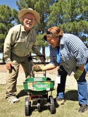 """John White, curator of the UTEP Chihuahuan Gardens, and Rhonda Diaz, Las Cruces Utilities water conservation program coordinator, show off """"black gold"""" to attendees at the Spring Stroll last May in the LCU Demonstration Garden."""