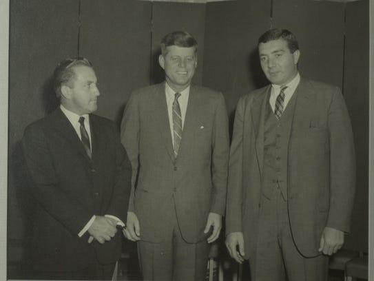Bernard Waterman stands with John F. Kennedy in an