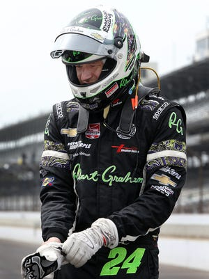 Dreyer and Reinbold-Kingdom RacingÕs Townsend Bell (24) prepares himself before practice for the Indianapolis 500 Thursday, May 14, afternoon at the Indianapolis Motor Speedway.
