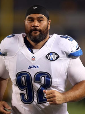 Detroit Lions defensive tackle Haloti Ngata jogs off of the field after playing the Pittsburgh Steelers on Aug. 12, 2016.