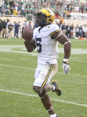 Michigan Wolverines' Jabrill Peppers runs back a two-point conversion attempt for two points late in the fourth quarter against the Michigan State Spartans on Saturday, Oct. 29, 2016 at Spartan Stadium in East Lansing.