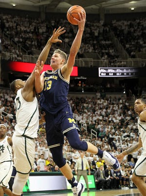 Michigan forward Moritz Wagner is defended by Michigan State forward Xavier Tillman in the first half Saturday.