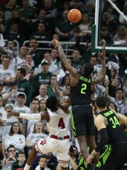 Michigan State forward Jaren Jackson Jr. blocks a shot by Indiana guard Robert Johnson during the second half of MSU's 85-57 win over Indiana on Friday, Jan. 19, 2018, at Breslin Center.