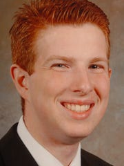 Brad Askew was one of five Crown College graduates and students killed in a traffic accident in Florida on 6/04/04.  Knoxville News Sentinel photo by Paul Efird.