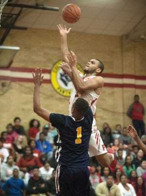 Paulsboro's Cherron Quarles shoots over Ja'Zere Noel of Woodbury during the third quarter of Tuesday's Colonial Conference game.