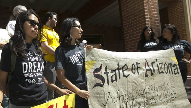 DREAMER and Phoenix College student Vianey Perez, (front center left) participates with others in a rally and press conference celebrating an Arizona judgement ruling in favor of the Maricopa County Community College Board and confirming that DACA recipients have the basic right to In-State Tuition, at Phoenix College on Wednesday, May 6, 2015.