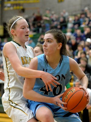 CMR's Allie Olsen, left, defends Erin Watt of Great Falls High during crosstown action last season. Both athletes are expected to be leaders of their respective teams this season.