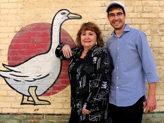 Sondra Underberg, left, hams it up with the goose mural to give Nathanial Darnell something to laugh about.