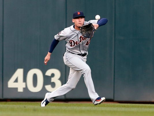 Detroit Tigers center fielder JaCoby Jones eyes the ball hit by Minnesota Twins' Brian Dozier, before making the catch for the out during the first inning of a baseball game Friday, April 21, 2017, in Minneapolis. (AP Photo/Jim Mone)
