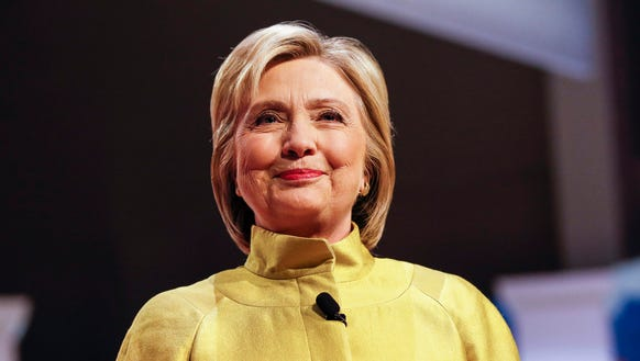 Hillary Clinton smiles during the PBS NewsHour Democratic