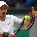 Britain's Andy Murray defeats French crowd favorite Richard Gasquet on Wednesday in Paris.