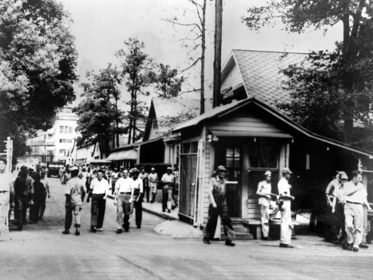 Hercules employees in the 1940s are shown at the gate