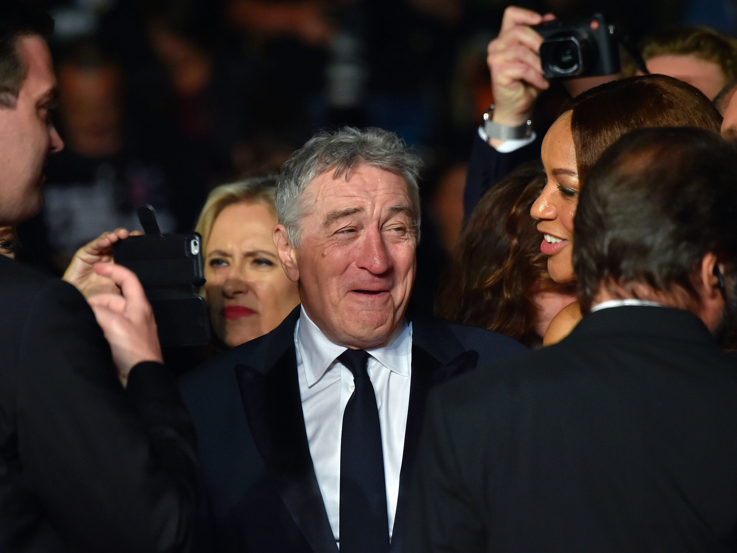 """Robert de Niro arrives or the screening of the film """"Hands of Stone"""" at the 69th Cannes Film Festival on Monday."""