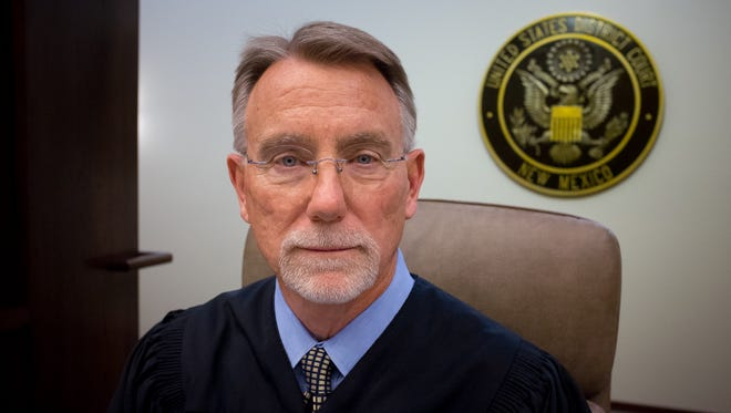 United States federal Judge Robert Brack sits behind the bench in the Guadalupe court, his courtroom at the U.S. District Court in Las Cruces. The judge named all eight courtrooms in the building after mountain ranges in New Mexico.