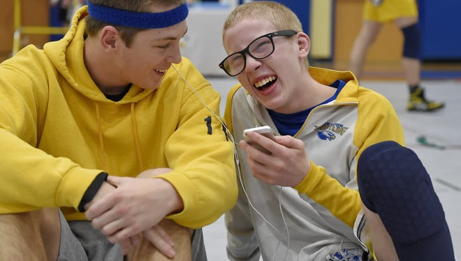 Eastside sophomore Jordie White, right, shares a laugh with teammate Jack Beehler during Saturday's Class AAAA Upper State tournament at Eastside. White is No. 1 at 113 pounds heading into this weekend's state tournament.