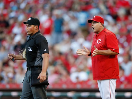 July 16: Cincinnati Reds manager Bryan Price, right,