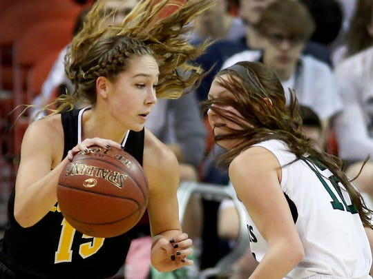 Cuba City's Chloe Pustina, left, tries to drive around Fall Creek's Shayna Hohlfelder in the first half of the Division 4 finals in the WIAA girls' state basketball championships.