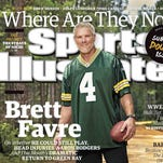 Brett Favre appears on the cover of a special, double issue of Sports Illustrated in a Green Bay Packers jersey.