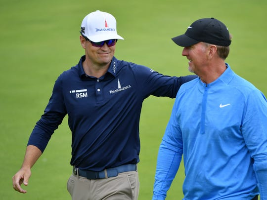 PORTRUSH, NORTHERN IRELAND - JULY 18: Zach Johnson of the United states embraces David Duval of the United States during the first round of the 148th Open Championship held on the Dunluce Links at Royal Portrush Golf Club on July 18, 2019 in Portrush, United Kingdom. (Photo by Stuart Franklin/Getty Images) ORG XMIT: 775282277 ORIG FILE ID: 1162780391