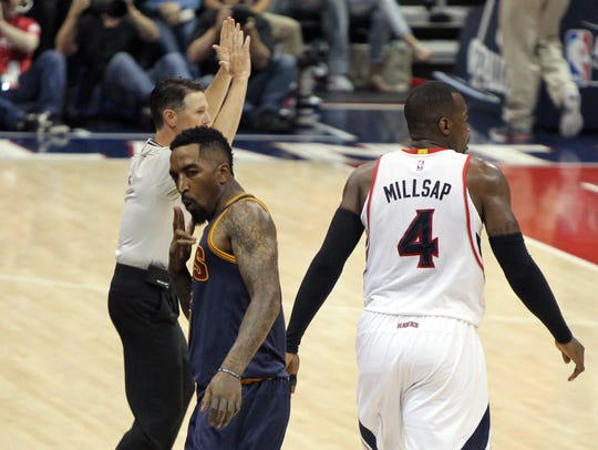 Cleveland Cavaliers guard J.R. Smith (5) reacts after