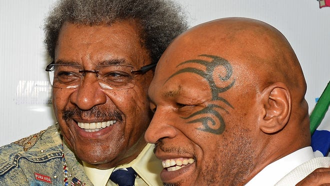 Boxing promoter and inductee Don King poses with former heavyweight champion and inductee Mike Tyson at the Nevada Boxing Hall of Fame inaugural induction gala