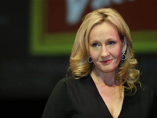 British author J.K. Rowling as she poses for the photographers during photo call in 2012 to unveil her new book, 'The Casual Vacancy.' Studio Warner Bros. announced Thursday that Rowling will write the screenplay for a movie based on 'Fantastic Beasts and Where to Find Them,' her textbook to the magical universe she created in the Potter stories. (AP Photo)